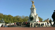 Stock Video Footage of Tourists rest below the Queen Victoria Memorial in London England UK