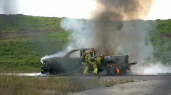 Firemen fighting truck fire Stock Footage