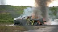 Firemen fighting truck fire Stock Footage