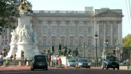Stock Video Footage of Black taxi cabs in The Mall with Buckingham Palace in the background in London.
