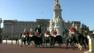 Stock Video Footage of Horse guards passing the Queen Victoria Memorial at Buckingham Palace London