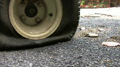 A Flat Tire In Driveway Next To Rural House Stock Footage