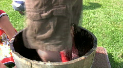 Man stomping grapes to make wine Stock Footage