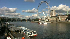 London Eye Millennium Wheel above the River Thames Westminster London Stock Footage