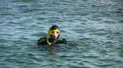 Scuba diver preparing a dive Stock Footage