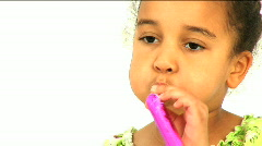 Blowing toy horns Stock Footage