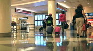 Passengers rushing about at the airport Stock Footage