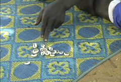 Cowery shells fortune telling Mali Stock Footage