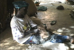 Cording wool Mali - stock footage