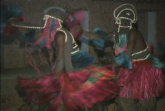 Dogon dancers in costumns Stock Footage