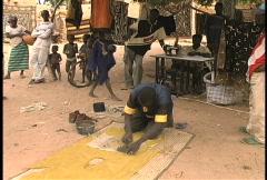 Dogon man making mud cloth Stock Footage