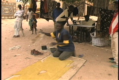 Making mud cloth in a dogon village Stock Footage