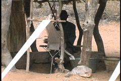 Dogon man weaving Stock Footage