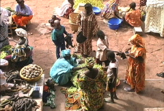 Selling food in a Mali market Stock Footage