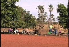 People at well Mali Stock Footage