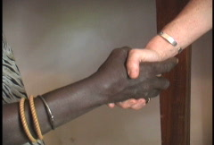 Shaking hands African & American - stock footage