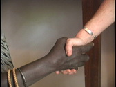 Shaking hands African & American Stock Footage