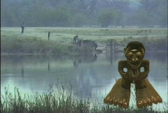 Big foot statue by river  Stock Footage