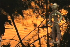 African art Figure and sunset water  Stock Footage