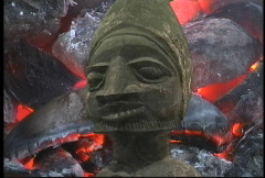 African art statue with burning coals  Stock Footage