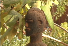 African art Statue with leaves  Stock Footage