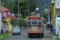 Bus going through street in Guatemala Stock Footage
