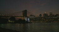 Stock Video Footage of pan shot brooklyn bridge night wide