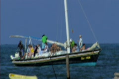 Crowded boat comming in Stock Footage