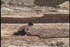 Making mud bricks Stock Footage