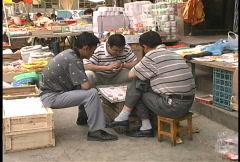 Western China Men playing game Dunhuang  Stock Footage