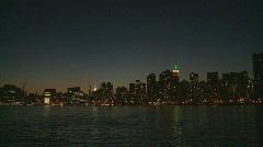 Skyline by night pan shot Stock Footage