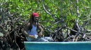 Stock Video Footage of Man with dreadlocks in boat