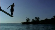 Stock Video Footage of silhouette of man diving 2