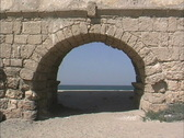 Stock Video Footage of Beach through aqueduct arch at Caesarea