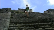 Tikal girl walking down steps Stock Footage