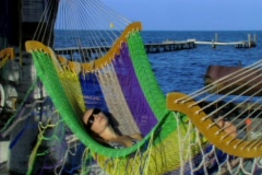 Woman swinging in hammock2 Stock Footage