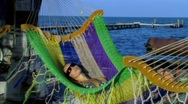 Stock Video Footage of Woman swinging in hammock2