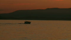 Sunset boat moving island Stock Footage