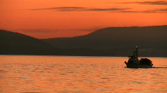 Sunset fishing boat mid crossing Stock Footage