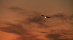 Sunset plane takeoff distant Stock Footage