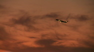 Stock Video Footage of sunset plane takeoff distant
