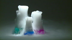 Three test tubes in action Stock Footage