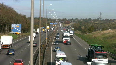 Traffic on the M1 motorway at the M6 junction Northamptonshire England. Stock Footage