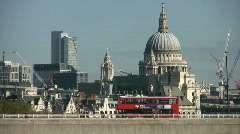 The dome of St Pauls cathedral stands above the traffic crossing Waterloo Bridge Stock Footage