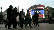 Stock Video Footage of Brightly lit advertisements at dusk in Piccadilly Circus London England UK