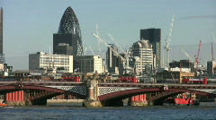 Blackfriars Bridge with the city office tower blocks in London England UK Stock Footage