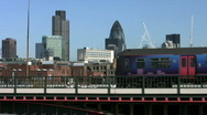 Stock Video Footage of Commuter train on Blackfriars Bridge with the city office tower blocks in London