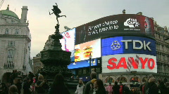 Eros and brightly lit advertisements at dusk in Piccadilly Circus London England Stock Footage