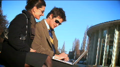 Business couple on laptop Stock Footage