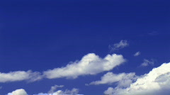 HD1080i White puffy clouds and blue sky (Time Lapse) Stock Footage